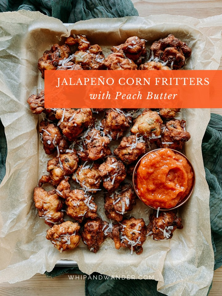 a bunch of Jalapeño Corn Fritters with a bowl of Peach Butter on a tray