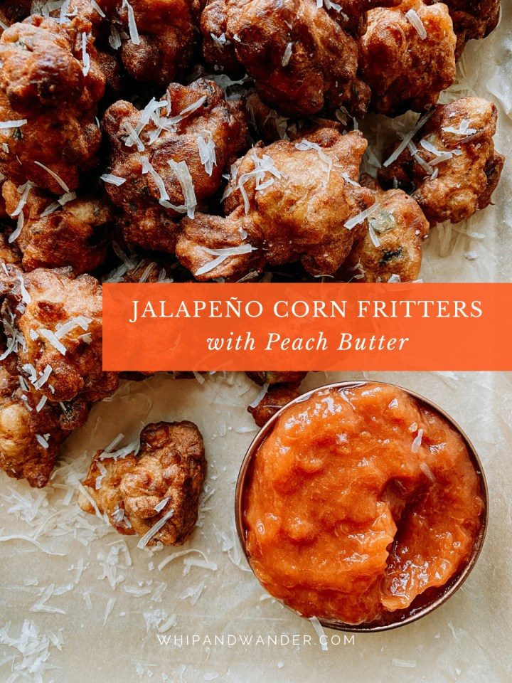 a small dish containing a peach butter dip next to a pile of corn fritters with jalapenos