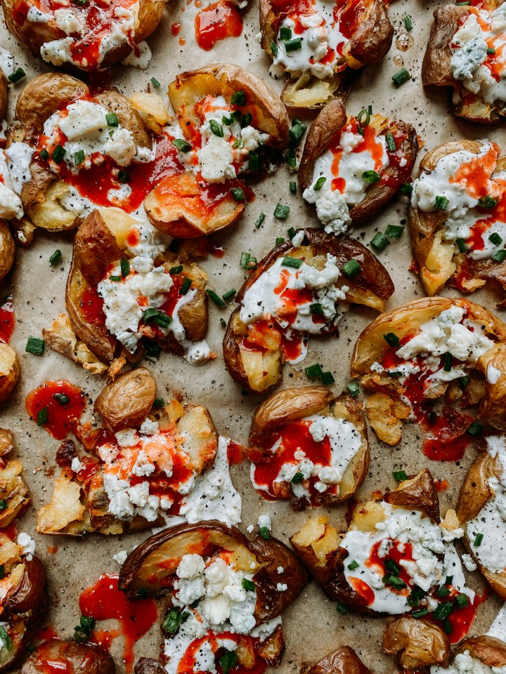 roasted potatoes dressed with buffalo sauce, blue cheese dressing, and fresh chives
