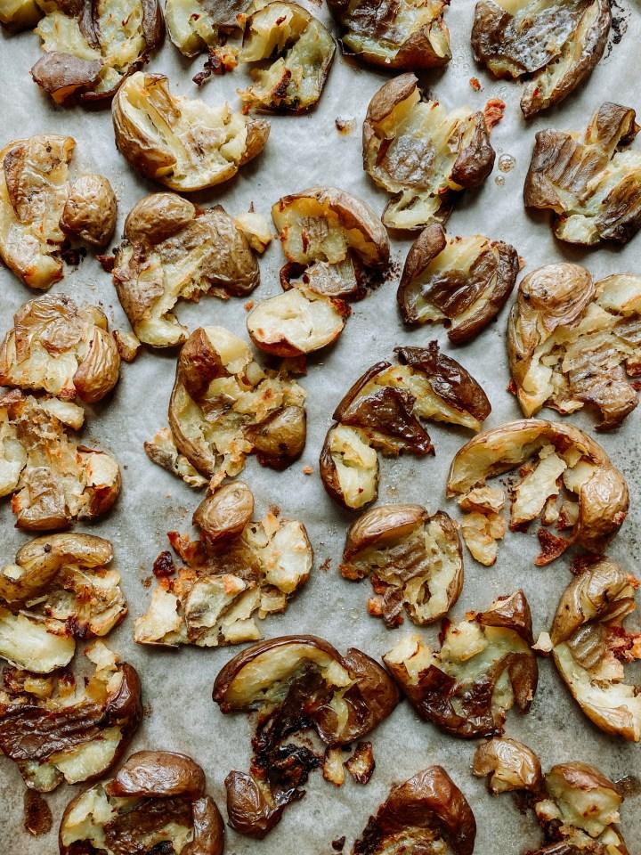 crispy smashed potatoes on a baking sheet