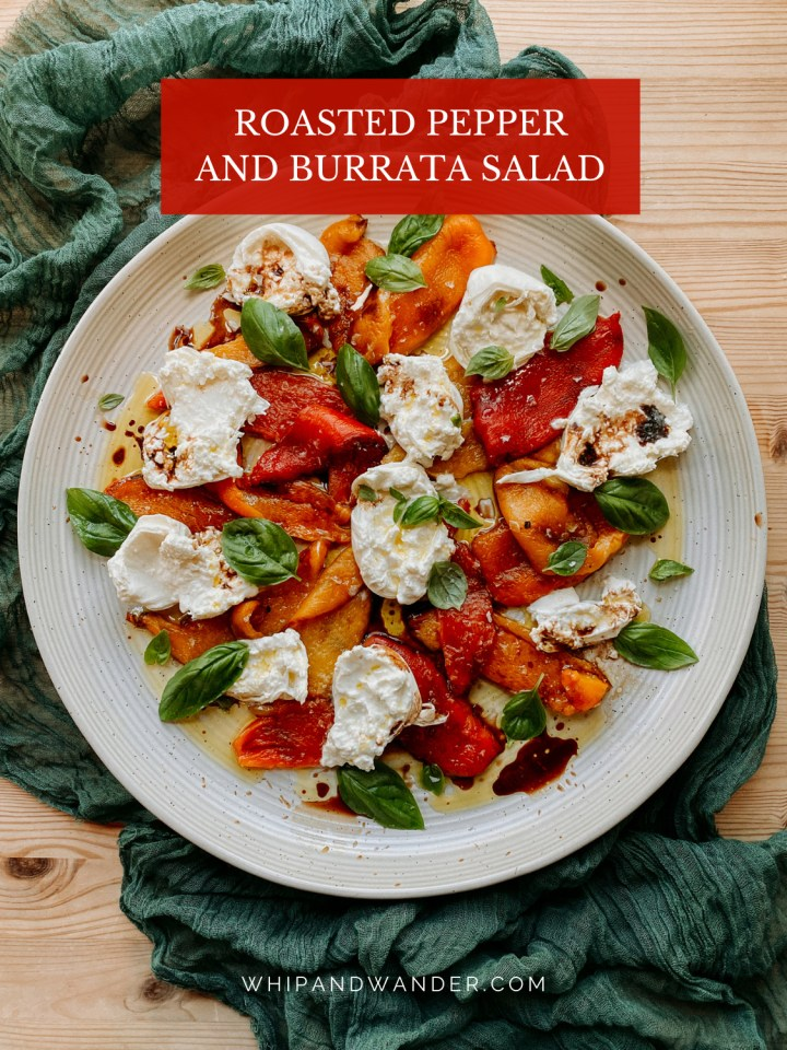 a large white platter with Roasted Pepper and Burrata Salad with basil on top