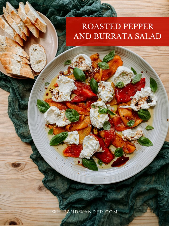 burrata, balsamic, olive oil, basil, and roasted peppers in a large round platter on a dark teal cloth