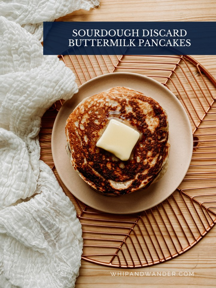 a top-down image of pancakes with melting butter on top