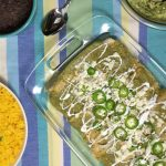 Chicken tomatillo enchiladas in a baking dish