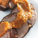 Spiced Pork Tenderloin topped with Tomato Peach Sauce