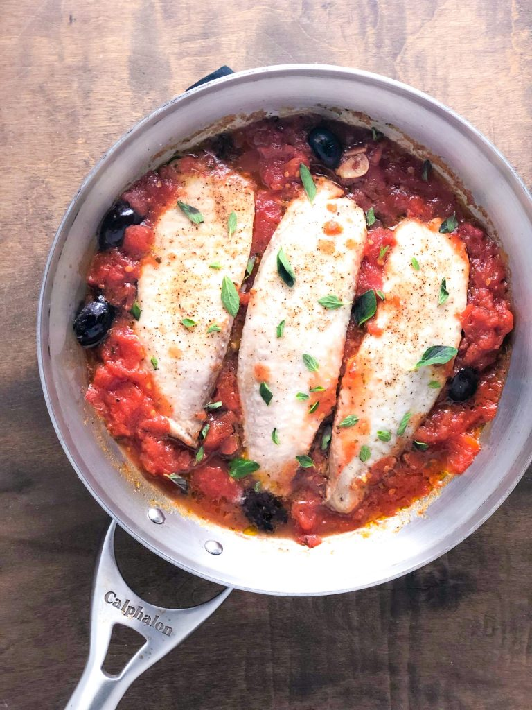 A pan of Whitefish in Tomato Sauce with Olives