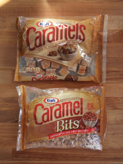 A bag of Kraft wrapped caramels (top) is sitting beside a bag of Kraft caramel bits (bottom), both on a wooden surface.