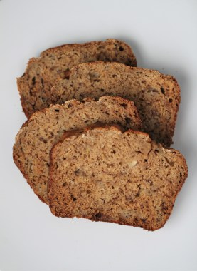 4 slices of Weight Watchers banana bread sit on top of one another against a white backdrop
