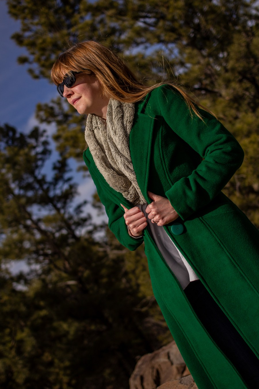 A woman wearing a green wool coat.