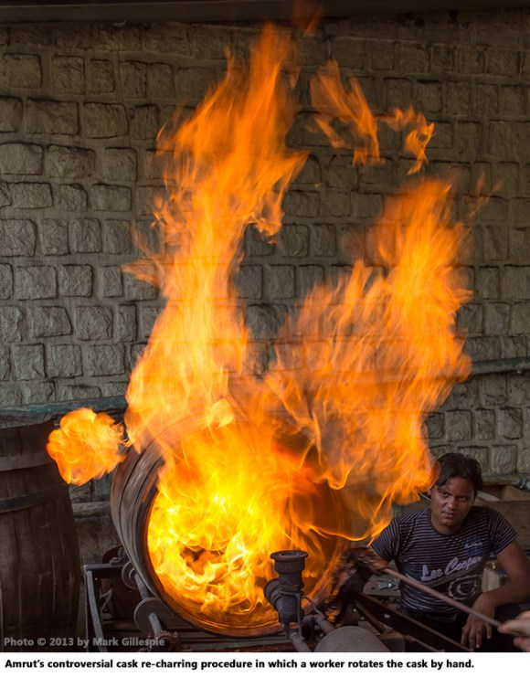 The controversial cask re-charring procedure at Amrut in which a worker rotates the cask.