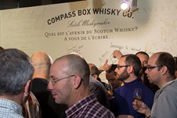 French whisky drinkers at the Compass Box booth during Whisky Live Paris September 28, 2015. Photo ©2015 by Mark Gillespie.