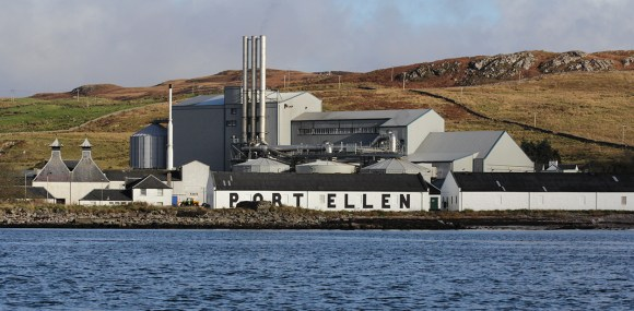 The Port Ellen Distillery and its warehouses, with Diageo's Port Ellen Maltings in the background. Photo ©2017, Mark Gillespie/CaskStrength Media.