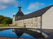 Convalmore Distillery reflected in a puddle