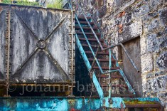 Rusty stairs outside the stillhouse of the closed Convalmore Distillery