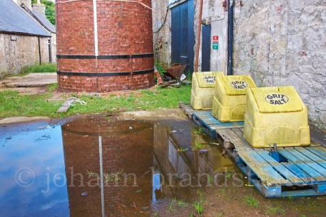 Reflections in a puddle behind the old Brora Distillery