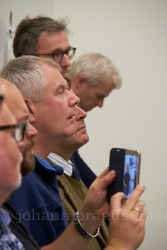 Whisky club listening with rapt attention to the explanations of the distiller