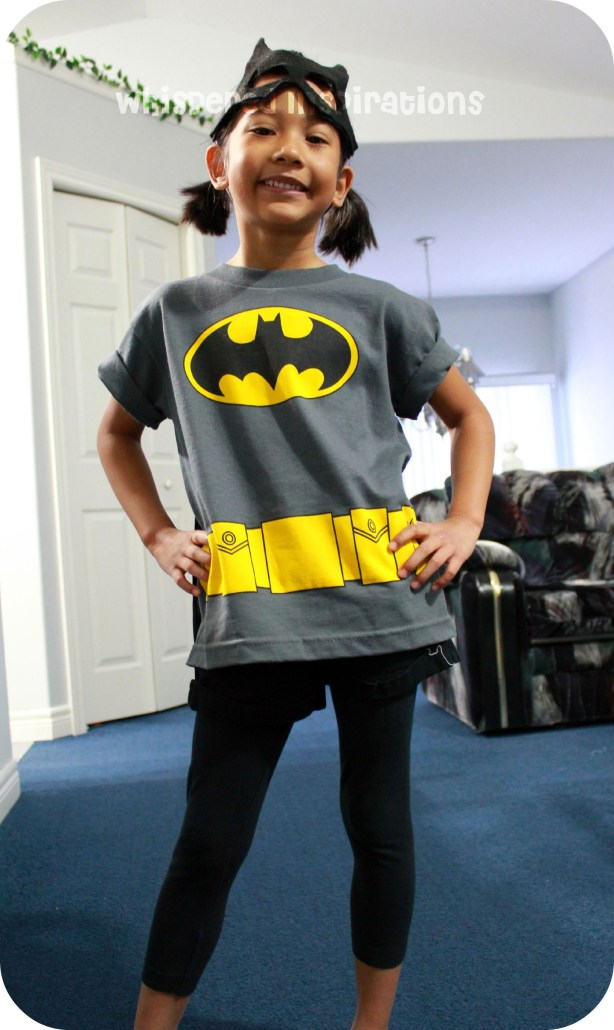 My Little Superhero. A girl shows off her batman shirt.