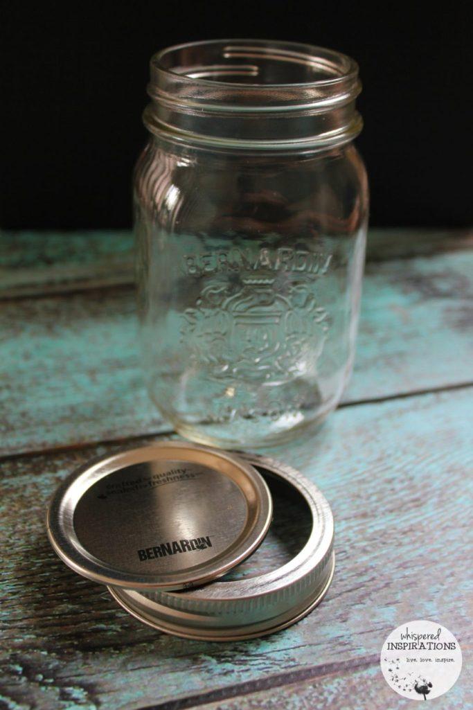 A Bernardin mason jar that is empty and awaiting organic strawberry and blueberry jam.