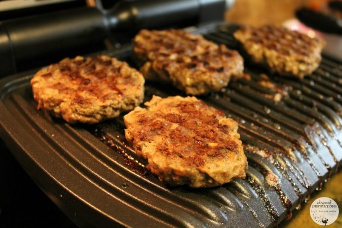 Beef burgers grilling on the T-fal Optigrill.