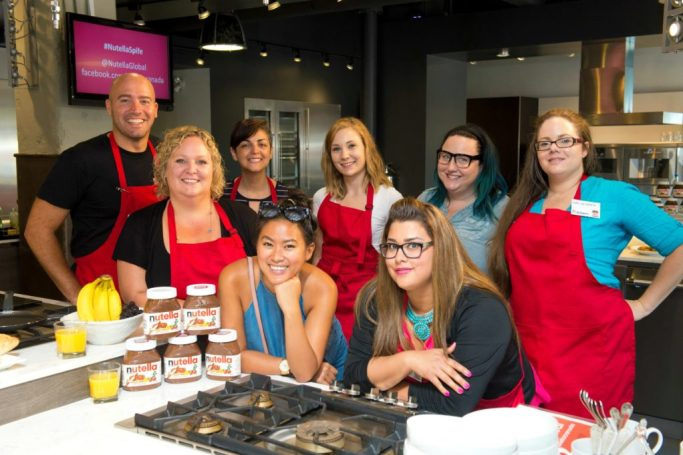 A group of writers in the Nutella kitchen with Chef Faita.