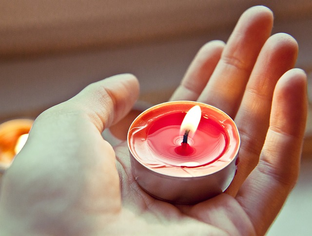 Image of a hand holding a candle representing the light and warmth of a Spiritual Healing Sitting