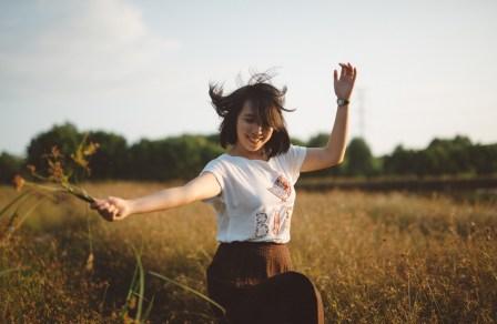 happy lady in field