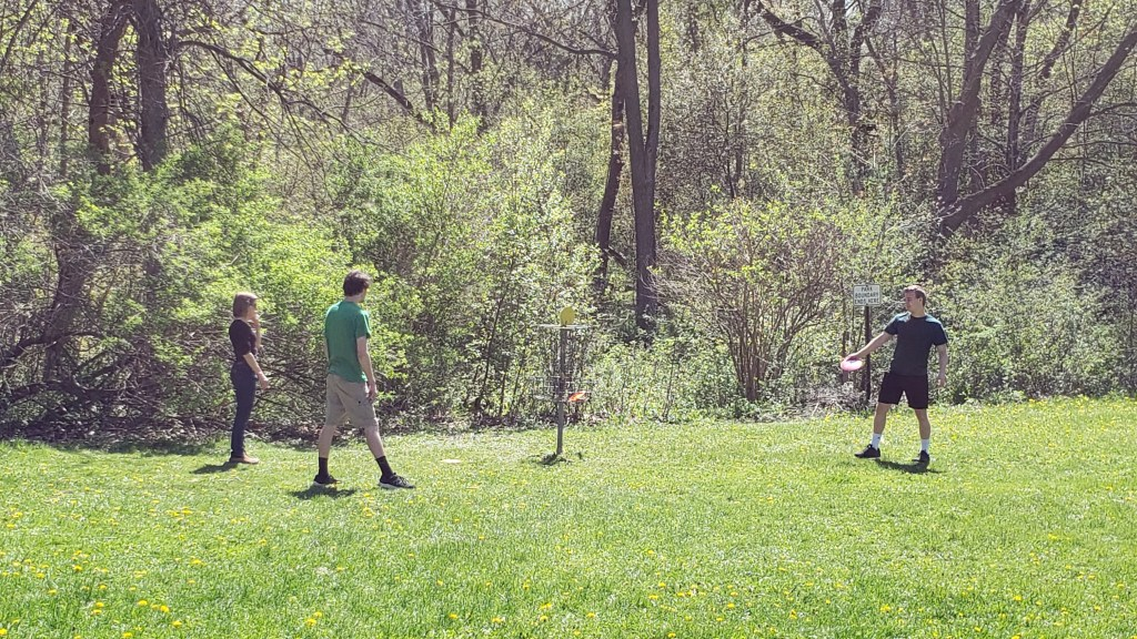 Mom and sons playing disc golf whispersofworth.com