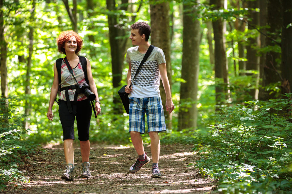 Mom connect with son while hiking in the woods Whispers of Worth
