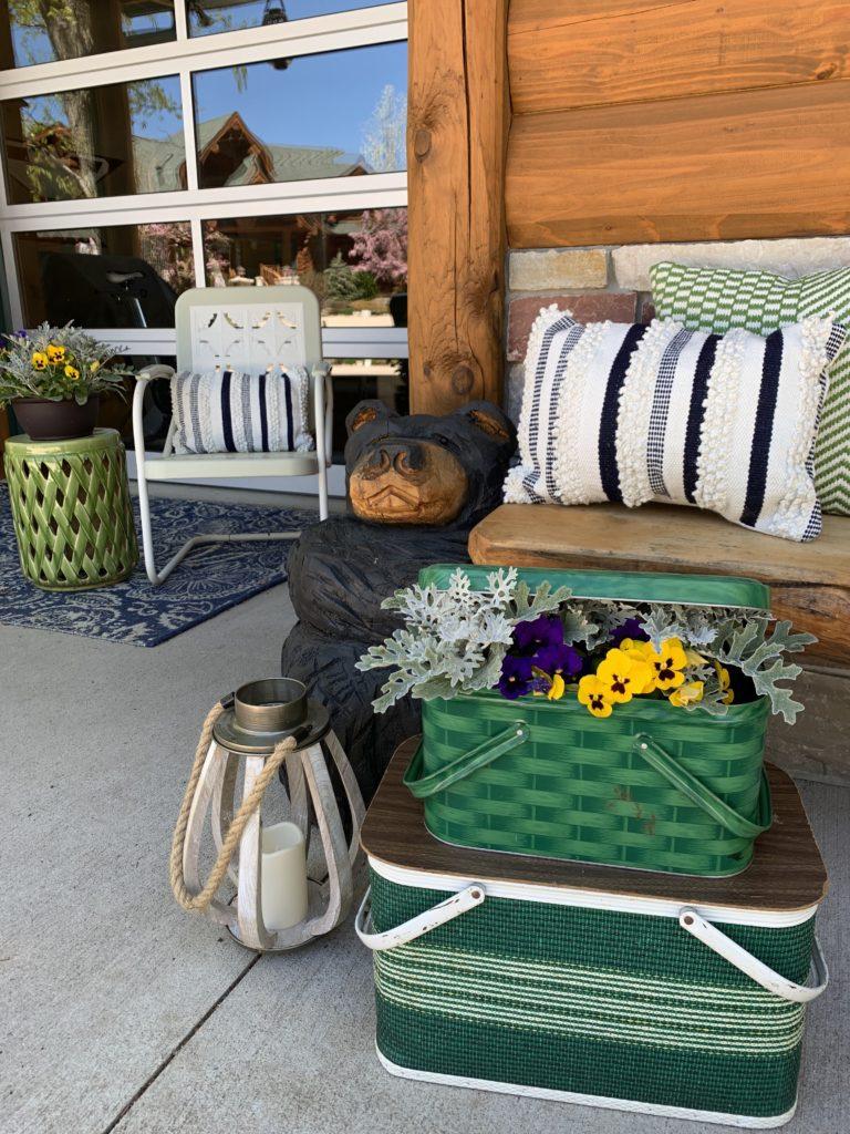 spring-summer-porch-cabin-carved-bear-vintage-picnic-basket-pansies