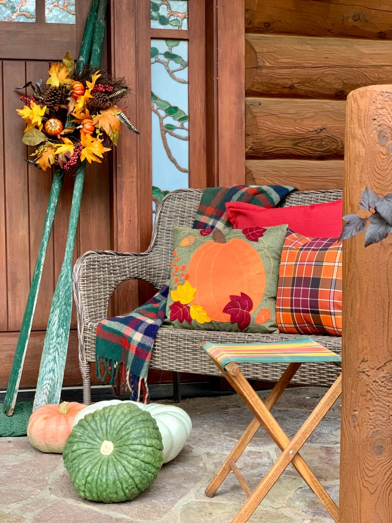 Front Porch of Lake House Cabin decorated for Fall in oranges and greens