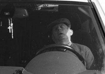 older-spanish-man-zonked-in-car-crop-2