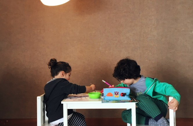 Childhood - siblings engrossed in arty activity