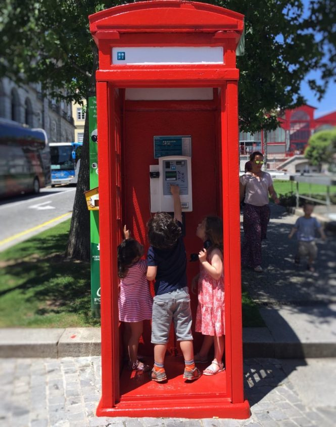 Red phone box in Porto's downtown
