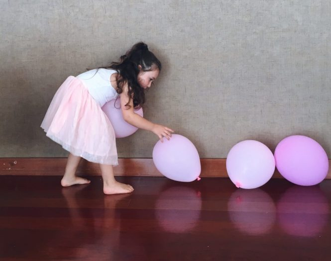 Dancing with pink balloons