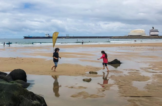 At the beach after the rain - reflections, childhood, siblings