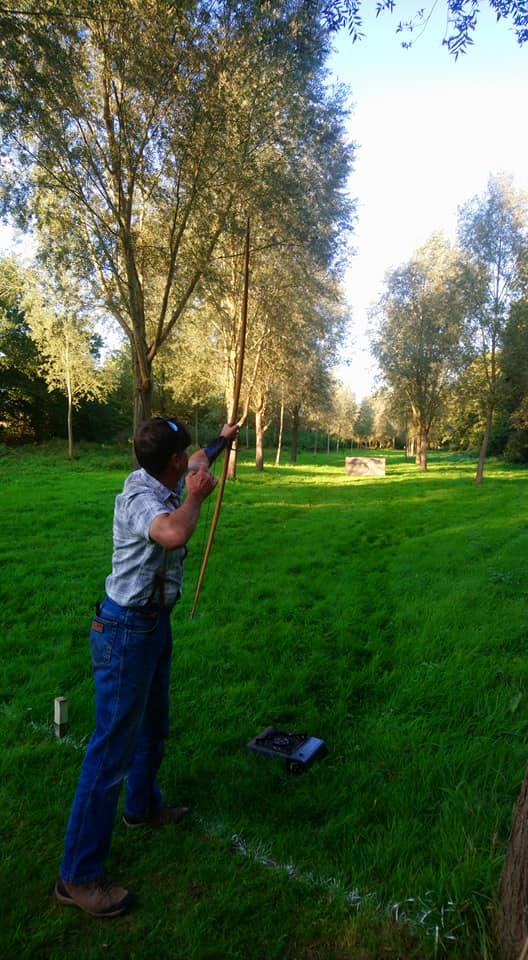 Man shooting a bow and arrow on the beginners' longbow archery course