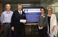 White Eagle presented a check to Marjor Johnson for the El Dorado Salvation Army.