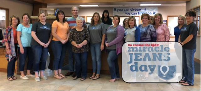 Group wearing jeans for Kansas Miracle Network