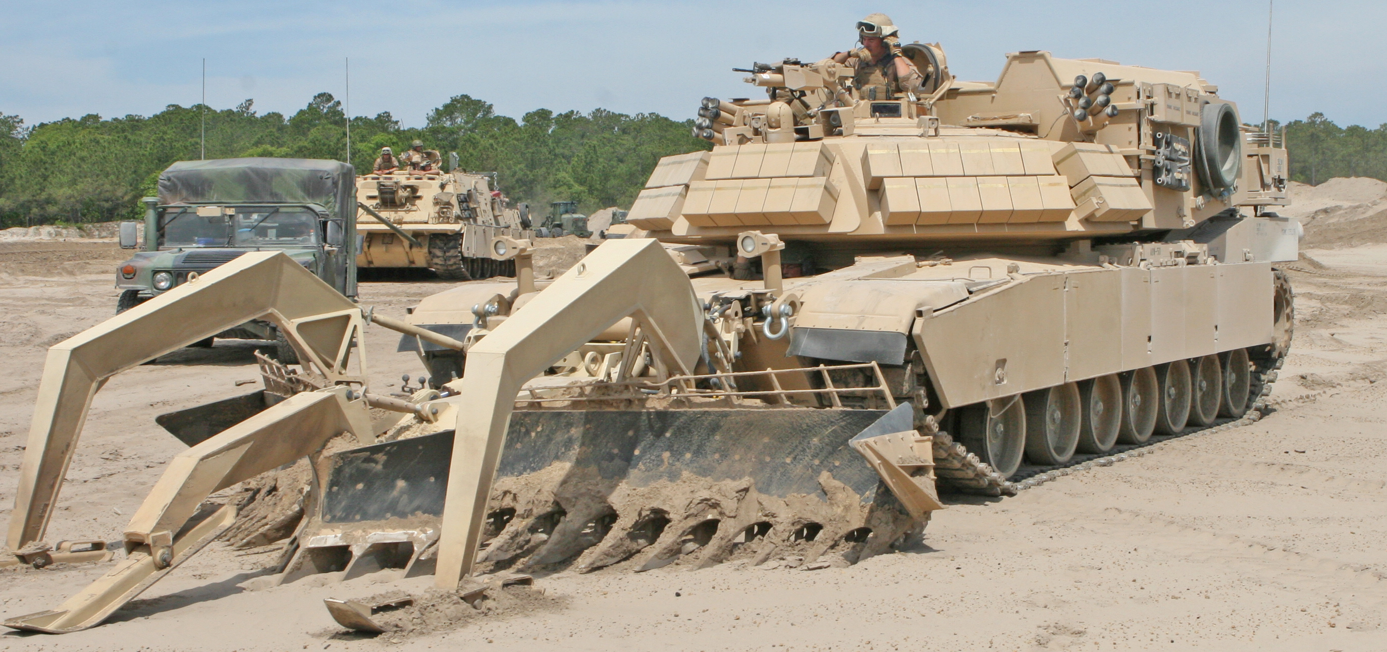 This fearsome looking American Assault Breacher Vehicle (ABV) is made to clear obstacles and alter the battlefield while under heavy fire. The implements at the front indicate that this is a combat engineering vehicle. Built from an Abrams tank chassis, the ABV is extremely durable.