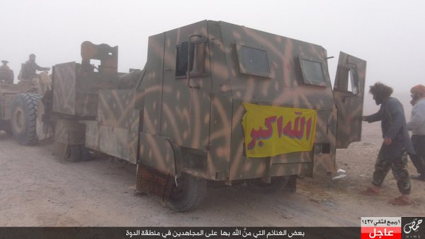 A typical example of improvised armor; this vehicle is merely a commercial truck with heavy metal plating added.