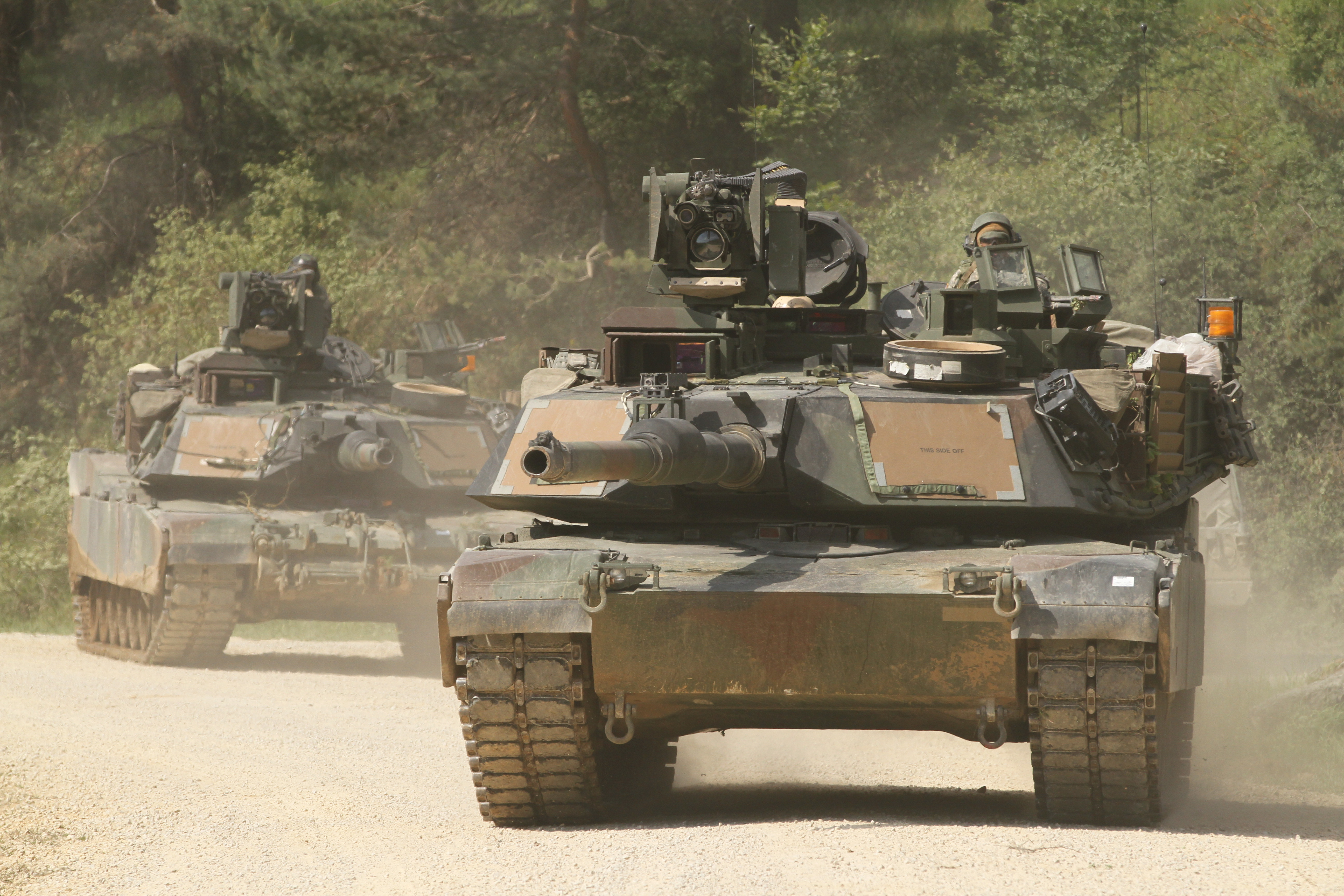 American M1A2 Abrams tanks conduct maneuvers in Germany during European exercises.