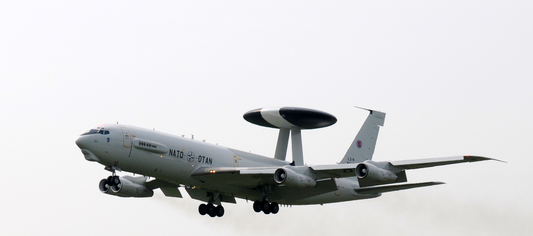 A NATO-owned Boeing 737 airborne early warning and control aircraft performs a touch-and-go landing.