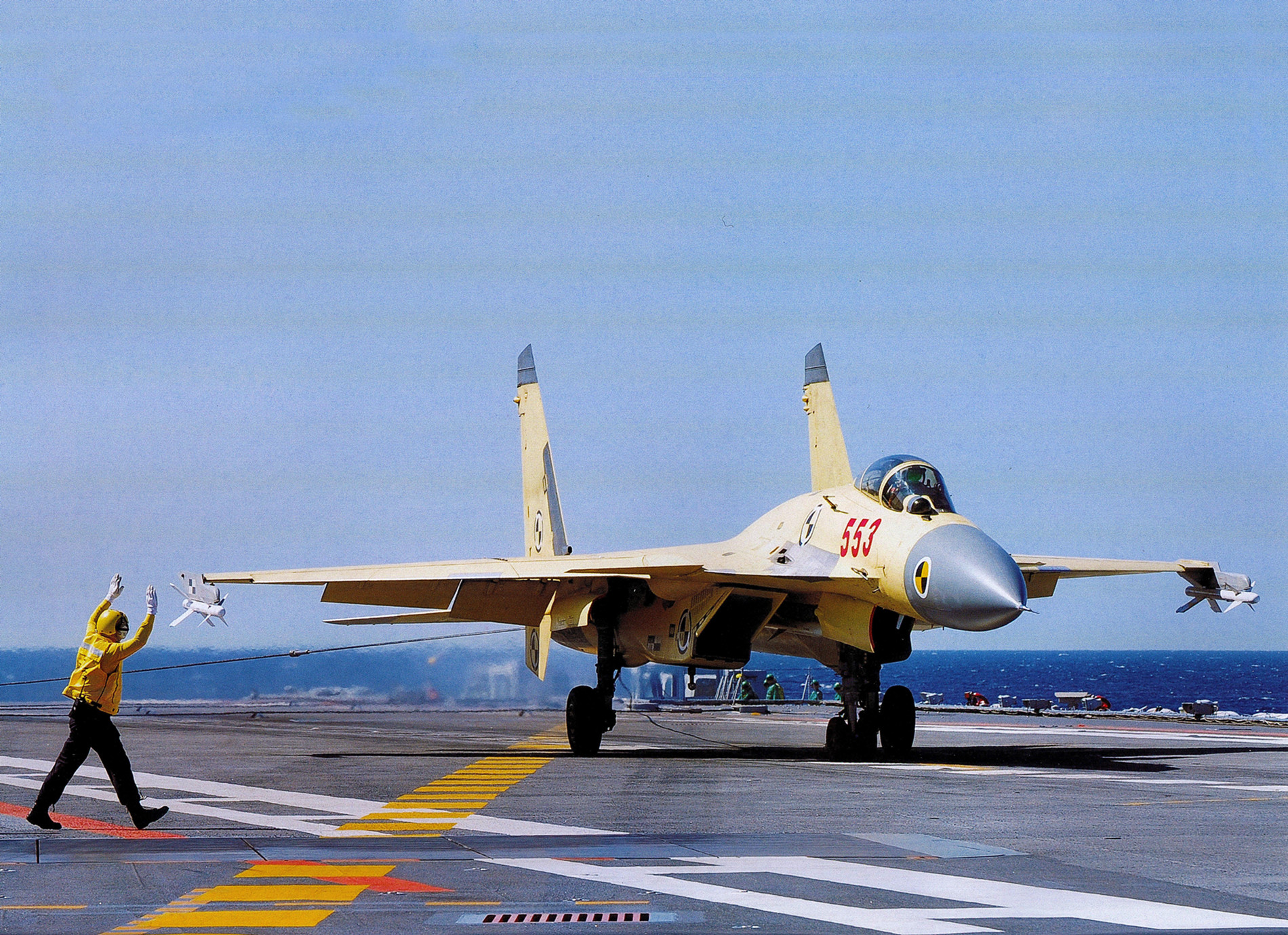 A Chinese J-15 carrier aircraft during testing (note the yellow livery and diagnostic paint scheme.