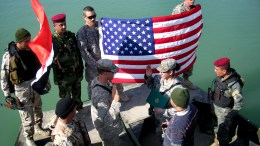 Soldier celebrates re-enlistment with Iraqi 'Swamp Cops'