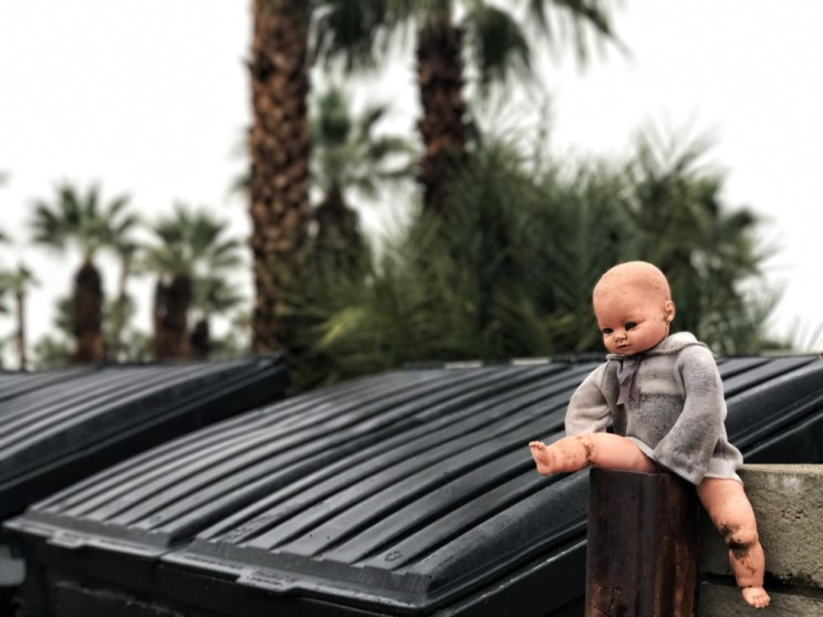 garbage baby hanging out at the dumpsters
