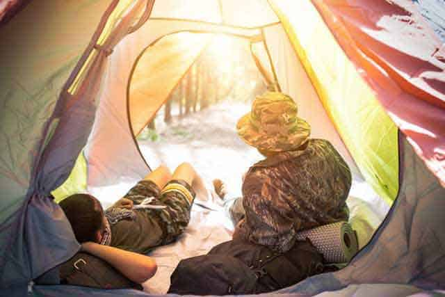 looking out from a tent on sunrise