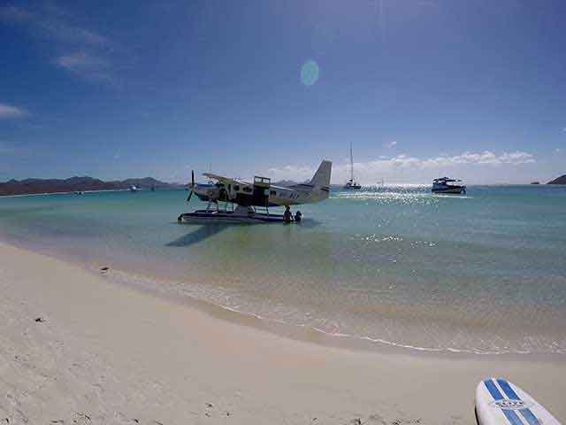 seaplane landing at the beach