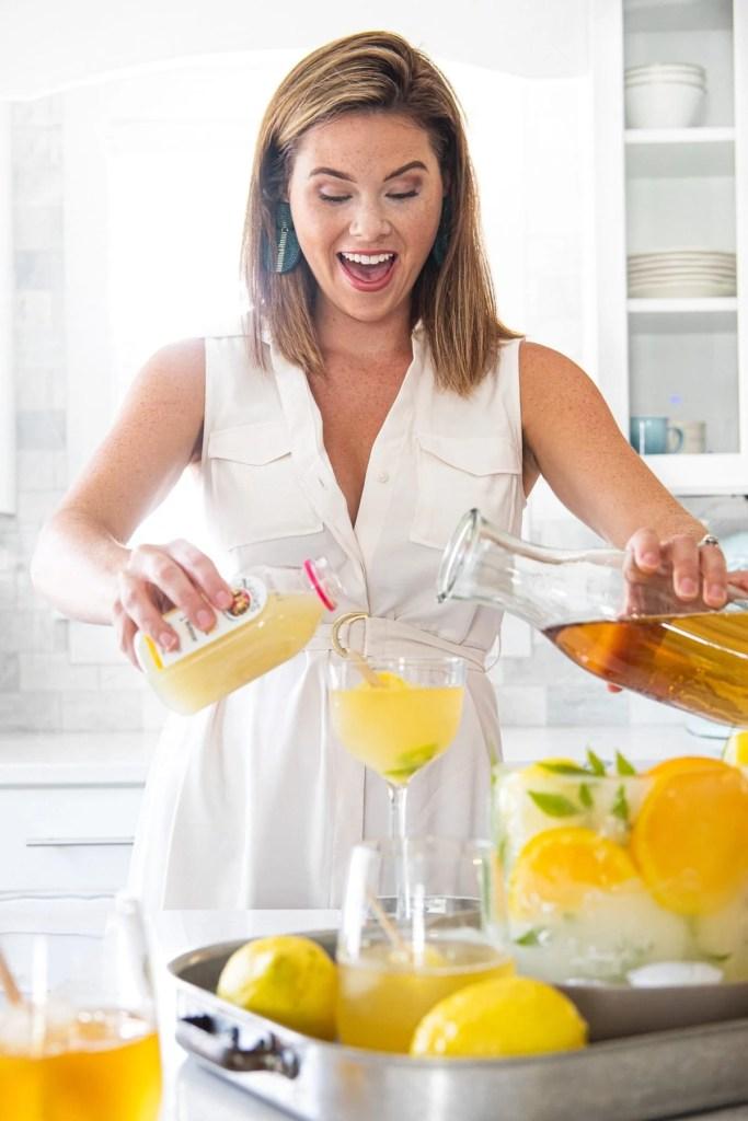 Sara mixing sweet tea and lemonade
