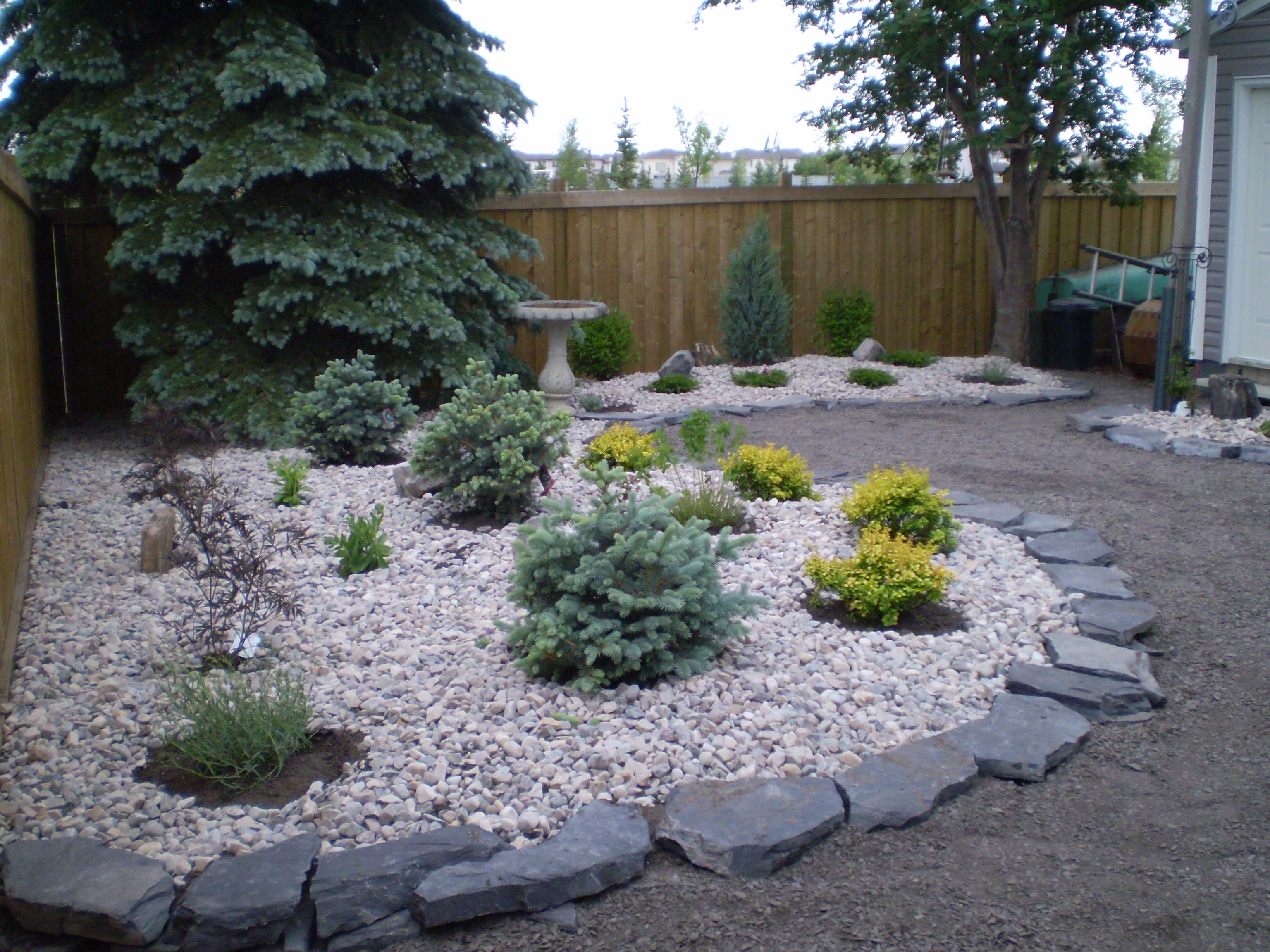 Low Maintenance Landscaping - Xeriscaping | Whitemud ... on Low Maintenance Backyard Designs  id=77111