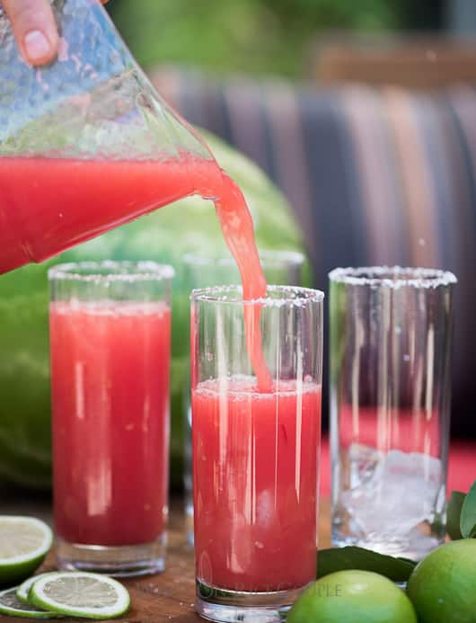 Watermelon Margaritas made inside a watermelon and blended together   @whiteonrice